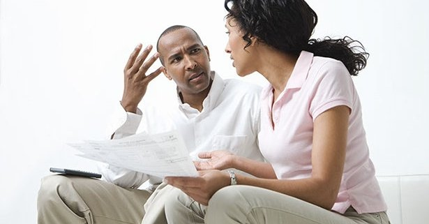 couple arguing when viewing bank statement