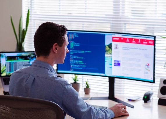 Man Working In Front of PC