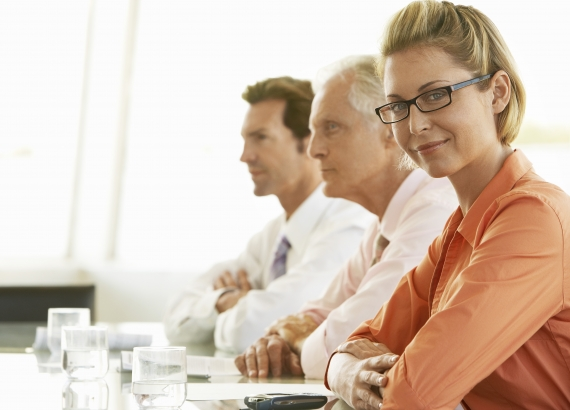 Woman in Conference Room wiht two Men